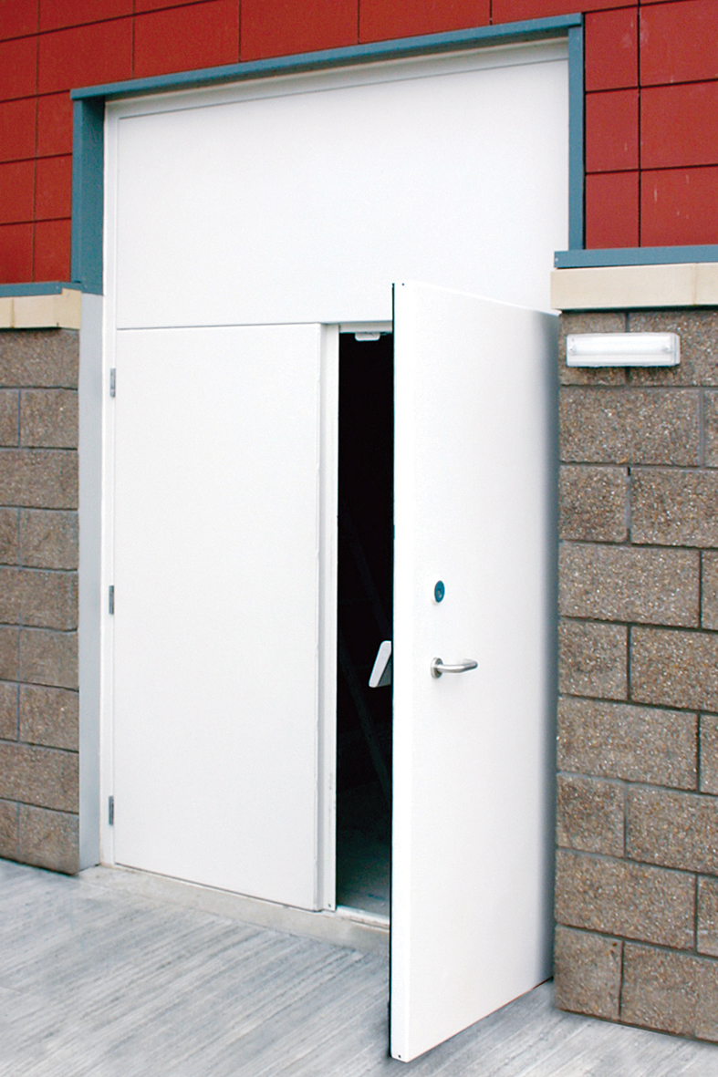 Frequent use twin access doors with blanking plate