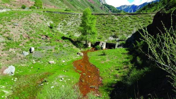 Dam of the tailing pond at Min-Kush